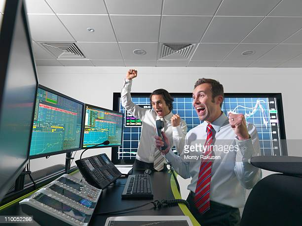 Successful financial trader and screens