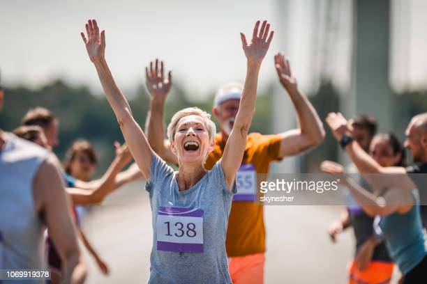 successful finish of marathon race! - finishing line stock pictures, royalty-free photos & images