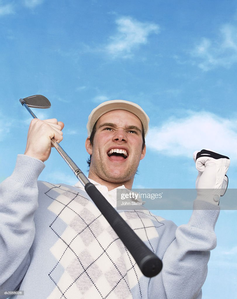 Successful Golfer Holding a Golf Club and Cheering : Stock Photo