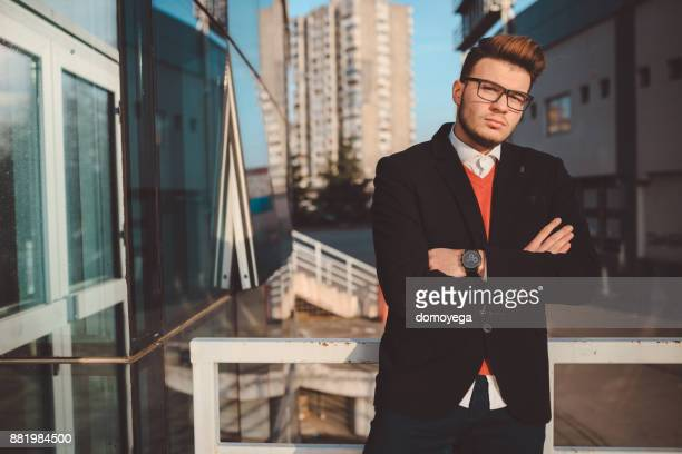 successful hipster in front of the office building - businesswear stock pictures, royalty-free photos & images