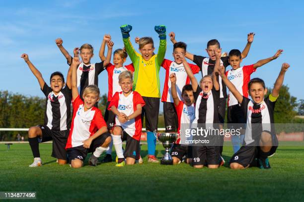 successful junior 10 years old professional soccer players jubilating - 10 11 years stock pictures, royalty-free photos & images