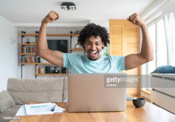Successful man working online at home