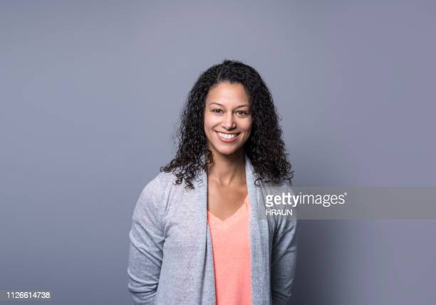 successful manager smiling on gray background - waist up stock pictures, royalty-free photos & images
