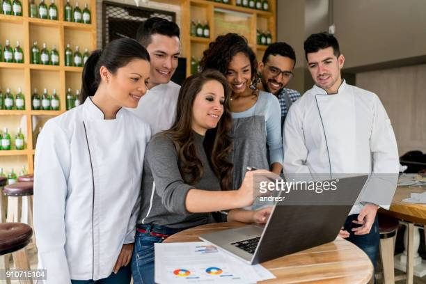 successful manager talking to the staff at a restaurant - wait staff stock pictures, royalty-free photos & images