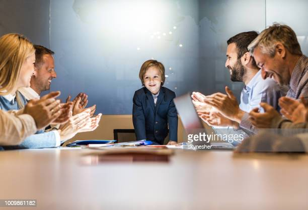 successful meeting of a happy business boy! - adult imitation stock pictures, royalty-free photos & images