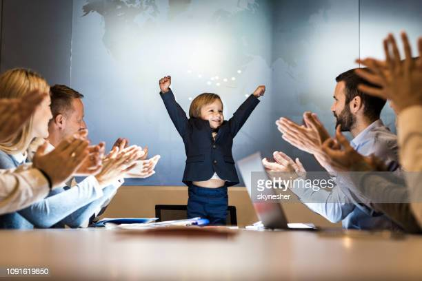 successful meeting of a happy business boy! - congratulations stock pictures, royalty-free photos & images