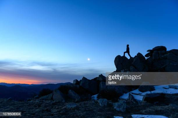successful men stand on the top of mountains - snow moon stock pictures, royalty-free photos & images