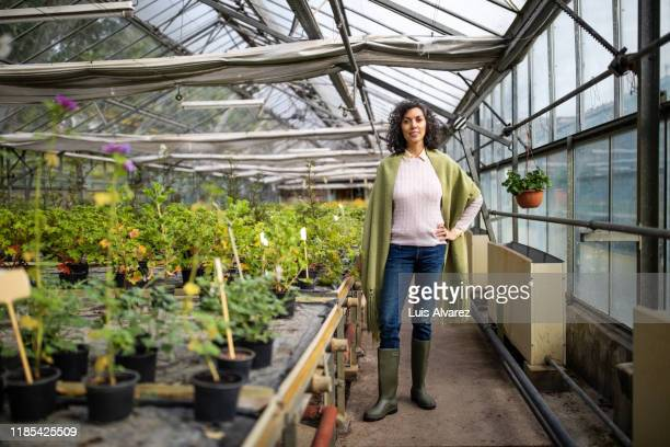 successful mid adult greenhouse owner - full length stock pictures, royalty-free photos & images