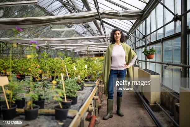 successful mid adult greenhouse owner - figura intera foto e immagini stock