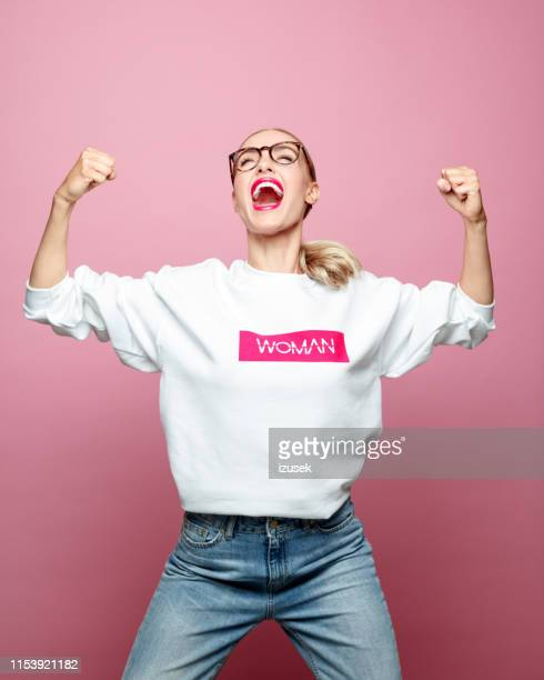 successful mid adult woman screaming - achievement stock pictures, royalty-free photos & images
