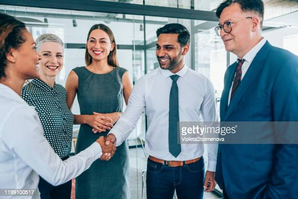 successful partnership - formal businesswear stock pictures, royalty-free photos & images