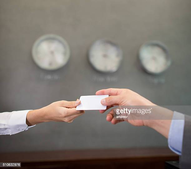 Successful people handling a business card