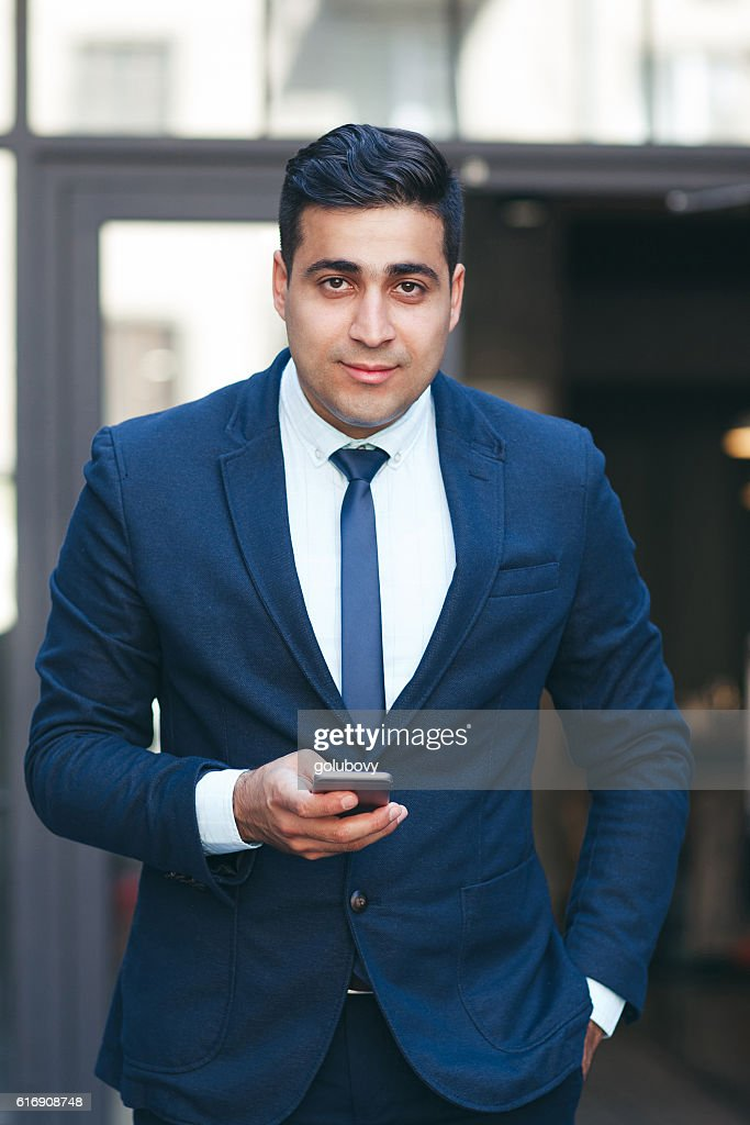 Successful rich businessman outdoors : Stock Photo