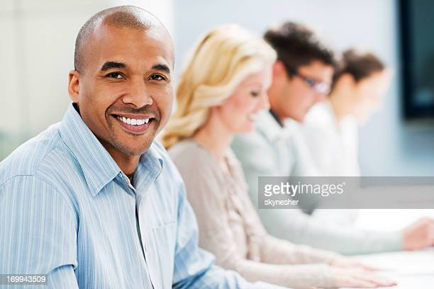 Successful smiling businessman on a meeting