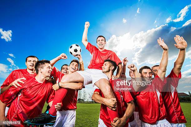 successful soccer team against the sky. - soccer team stock pictures, royalty-free photos & images