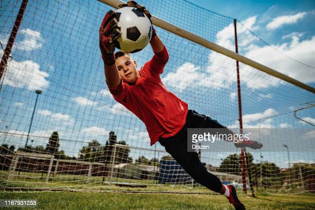 successful teenager goalkeeper - goalie stock pictures, royalty-free photos & images