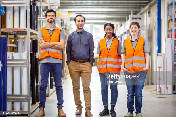 successful warehouse staff - reflective clothing stock pictures, royalty-free photos & images