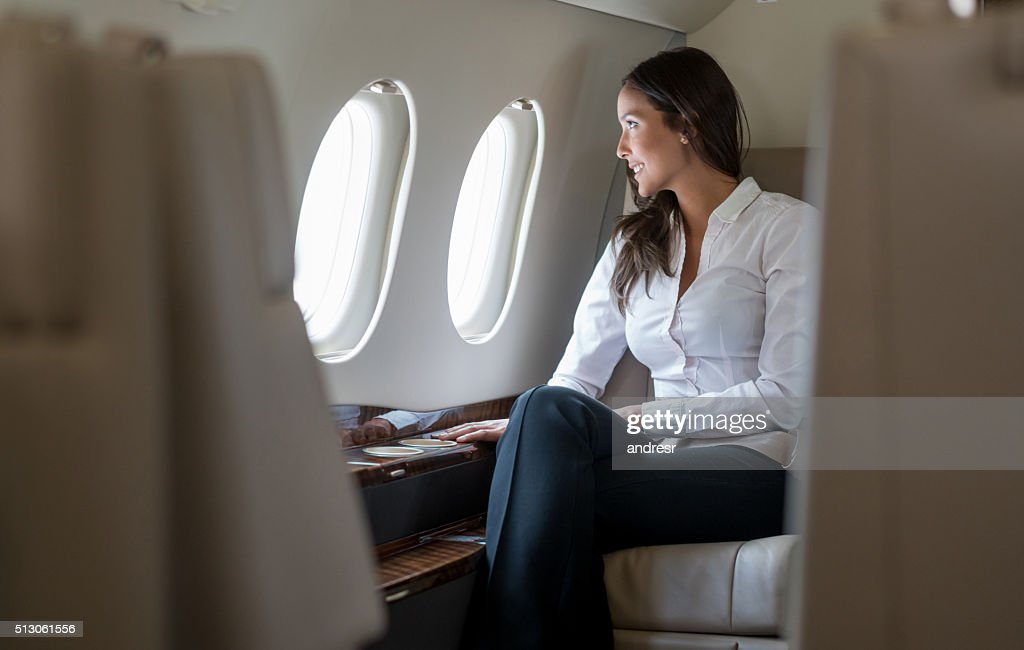 Successful woman in a business trip : Stock Photo