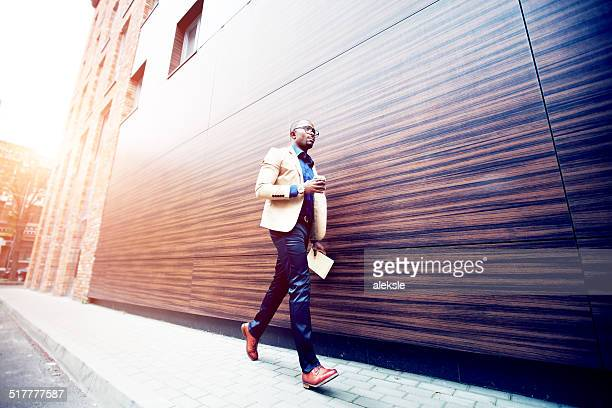 Successful young african man with book and coffee