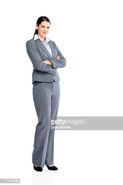 Erfolgreiche junge Geschäftsfrau auf Weiß
