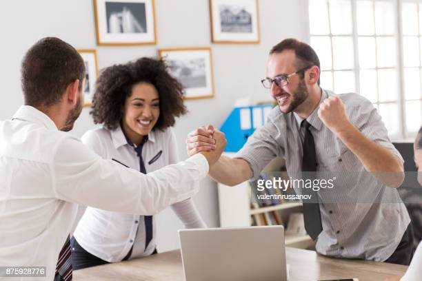 Successful young team having fun at workplace