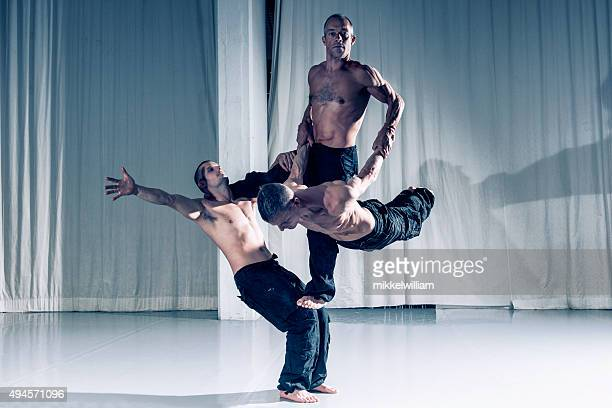 sucessful teamwork with three professional acrobats - acrobatic activity stock photos and pictures