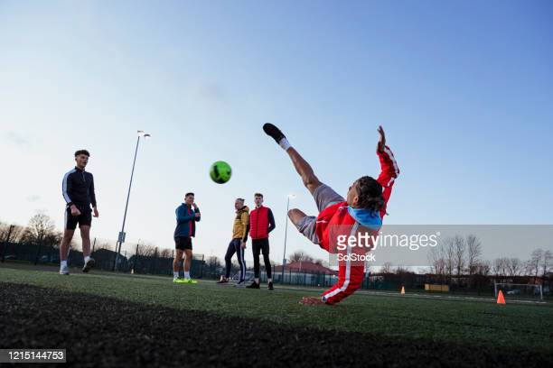 such a good kick - football player stock pictures, royalty-free photos & images