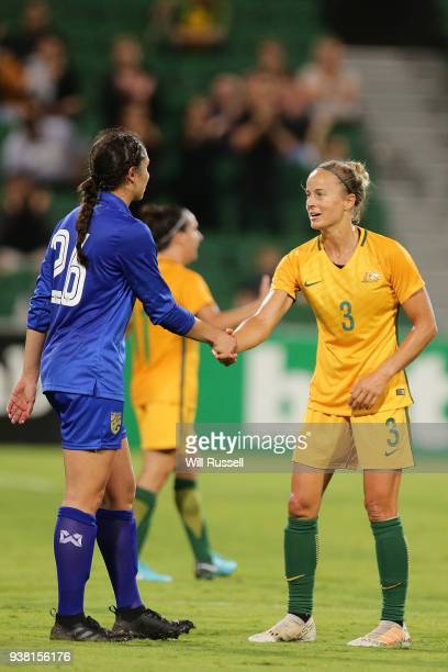 Suchawadee Nildhamrong of Thailand shakes hands with Aivi Luik of the Matildas during the International Friendly Match between the Australian...