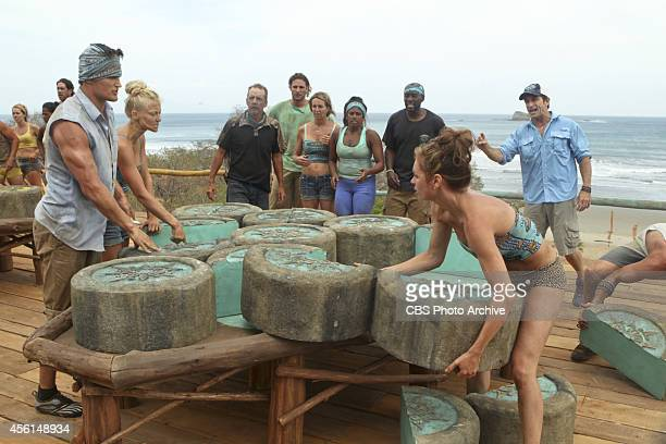 Suck It Up and Survive Jeff Probst watches as Jon Misch Kelley Wentworth and Julie McGee try to solve the Immunity puzzle during a special 90 minute...