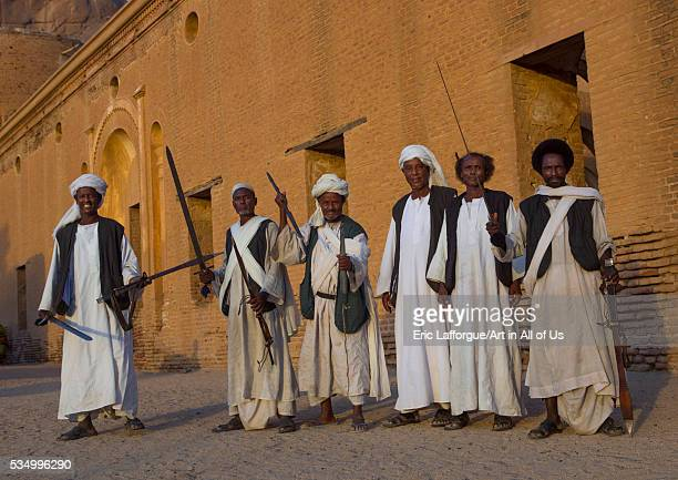 Sudan Kassala State Kassala beja tribe men dancing in front of the khatmiyah mosque at the base of the taka mountains