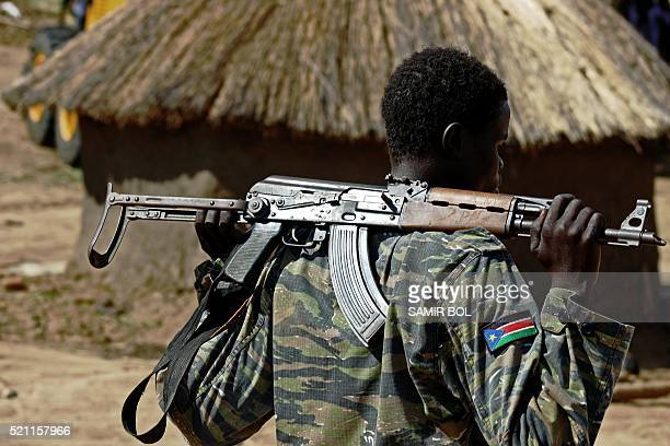 Sudan People's Liberation Army soldier holds a gun at a containment site outside Juba on April 14 2016 The soldiers at the site are the Tiger...