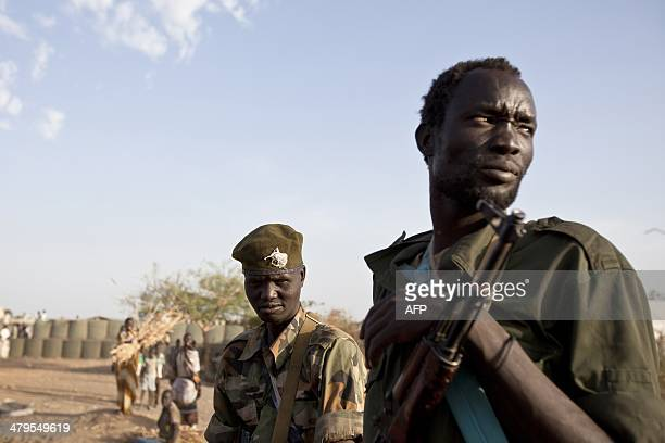 Sudan People's Liberation Army soldiers arrive at the United Nations Mission in the Republic of South Sudan base in Malakal after the SPLA claimed it...