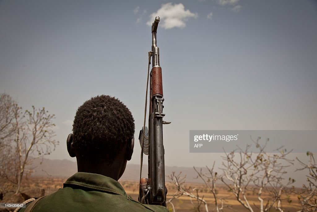 A Sudan People's Liberation Movement (SPLA-N) rebel soldier looks out toward Talodi, in South Kordofan, a region of Sudan, on April 25, 2012. After an initial attack by SPLA-N rebel forces in South Kordofan, thousands of people from the Nuba Mountains have fled to neighboring Yida to escape the fighting and retaliatory airstrikes by Khartoum's Sudan Armed Forces (SAF). AFP / Adriane Ohanesian
