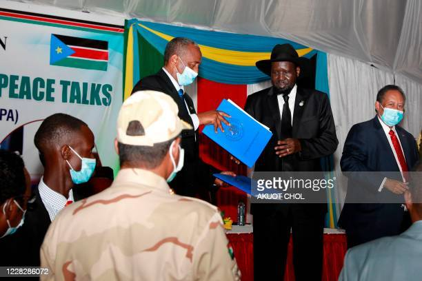Sudan president of the military transitional Abdel Fattah Sudan President Salva Kiir exchanging the signed documents during the singing of the Sudan...