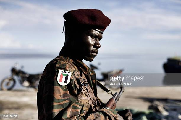 A Sudanese African Union troop waits to be transferred after disembarking in the port of Fomboni the capital of Moheli on 20 March 2008 A first...