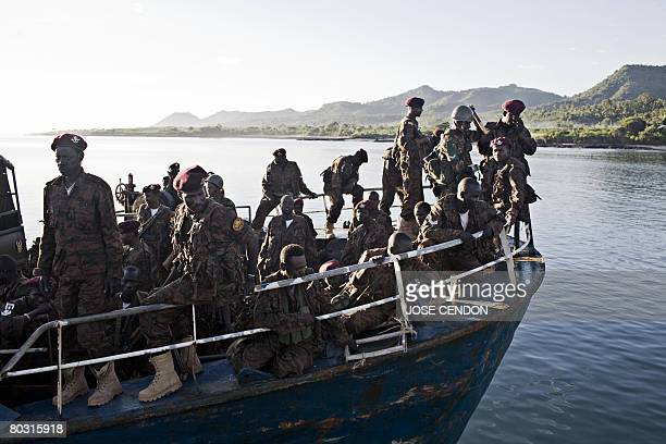 Sudanese African Union troops arrive in the port of Fomboni the capital of Moheli on 20 March 2008 A first detachment of 300 troops mandated by the...