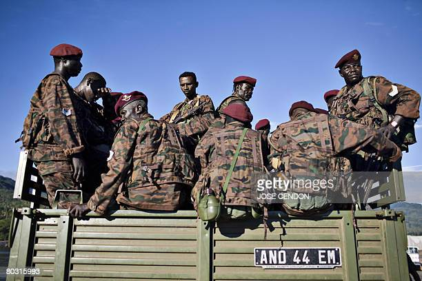 Sudanese African Union troops sit in a truck after disembarking in the port of Fomboni the capital of Moheli on 20 March 2008 A first detachment of...