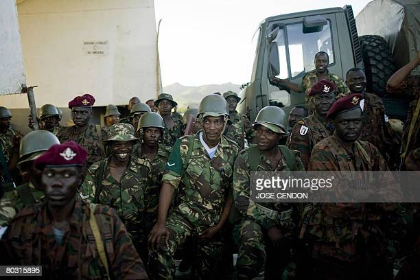 Sudanese and Tanzanian African Union troops arrive in the port of Fomboni the capital of Moheli on 20 March 2008 A first detachment of 300 troops...