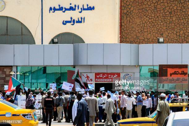 Sudanese aviation professionals rally in support of civilian rule at Khartoum airport in the capital on May 27, 2019.