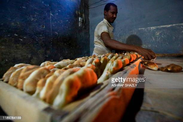 Sudanese bakers prepare bread at a bakery in the industrial town of Atbara northeast of Sudans capital Khartoum, on December 16, 2019. - In December...