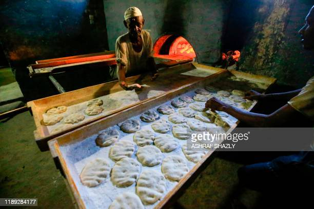 Sudanese bakers prepare bread at a bakery in the industrial town of Atbara northeast of Sudans capital Khartoum on December 16 2019 In December 2018...