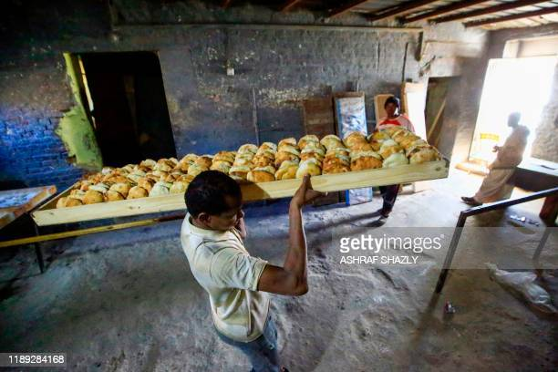 Sudanese bakers prepare bread at a bakery in the town of Atbara, an industrial town northeast of Sudans capital Khartoum, on December 16, 2019. - In...