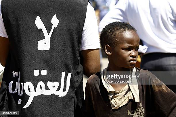 A Sudanese boy demonstrates outside the US embassy in the capital Khartoum on November 3 to protest against sanctions imposed on their country by the...