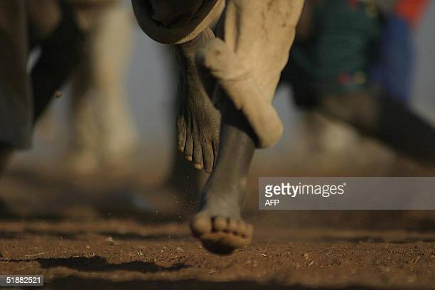 Sudanese boy runs and plays at alSereif refugee camp in the outskirts of Nyala in the southern Darfur region 09 December 2004 The Africa Union must...