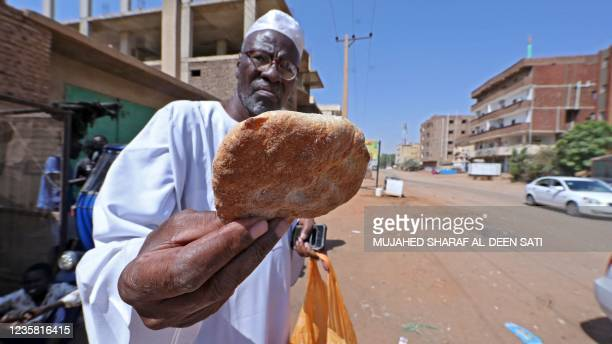 Sudanese buy bread from a bakery in the capital Khartoum on October 11 as the country is suffering from shortages of wheat and other essential...