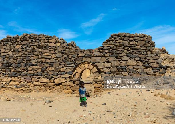 Sudanese child in gate in al Ghazali christian monastery Northern State Wadi Abu Dom Sudan on December 27 2018 in Wadi Abu Dom Sudan
