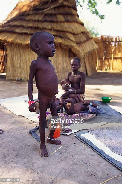 Sudanese child waiting at feeding center Due to flooding war and a ban on relief flights by Sudan's Islamic government many Sudanese have been left...