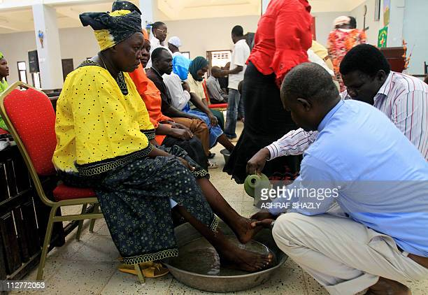 Sudanese Christians attend 'washing of the feet' ritual at a church in Khartoum on April 21 2011 as the the diminished Christian community in...