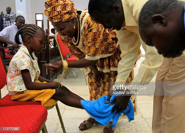 """Sudanese Christians attend """"washing of the feet"""" ritual at a church in Khartoum on April 21, 2011 as the the diminished Christian community in..."""