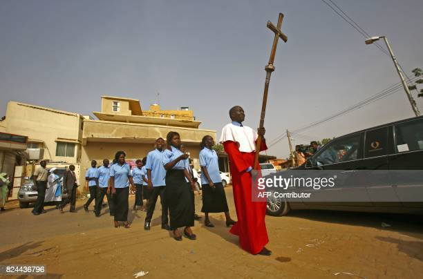 TOPSHOT Sudanese Christians take part in a ceremony led by the Archbishop of Canterbury at Khartoum's All Saints Cathedral on July 30 2017 Archbishop...